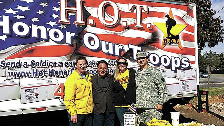 From left, Zak Becker, Jose Cuevas from JumBurrito, Beth Meeks and Sgt. Perez David from Honor Our Troops team to gather donations for care packages to send to soldiers overseas Photo: Courtesy Photo