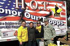 From left, Zak Becker, Jose Cuevas from JumBurrito, Beth Meeks and Sgt. Perez David from Honor Our Troops team to gather donations for care packages to send to soldiers overseas