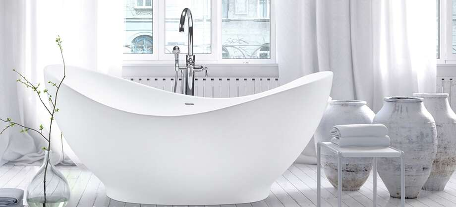 """The """"garden tubs"""" popular in the 1990s are being replaced by more efficient, practical, space-saving models. Current bathtub trends include freestanding tubs that require less floor space."""
