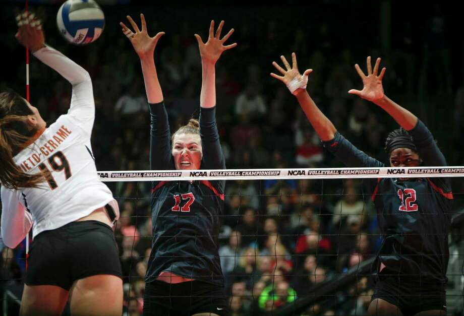 FILE - In this Dec. 17, 2016, file photo, Stanford's Merete Lutz (17) rises for a block with teammate Inky Ajanaku (12) on a shot from Texas' Paulina Prieto-Cerame (19) during the women's NCAA volleyball title game in Columbus, Ohio. Stanford won the title. The Cardinal are ranked No. 2 in the preseason American Volleyball Coaches Association poll behind Texas despite getting more first-place votes than the Longhorns. (Joshua A. Bickel /The Columbus Dispatch via AP, File) Photo: Joshua A. Bickel, MBR / © 2016 Joshua A. Bickel/Dispatch Media Group/The Columbus Dispatch