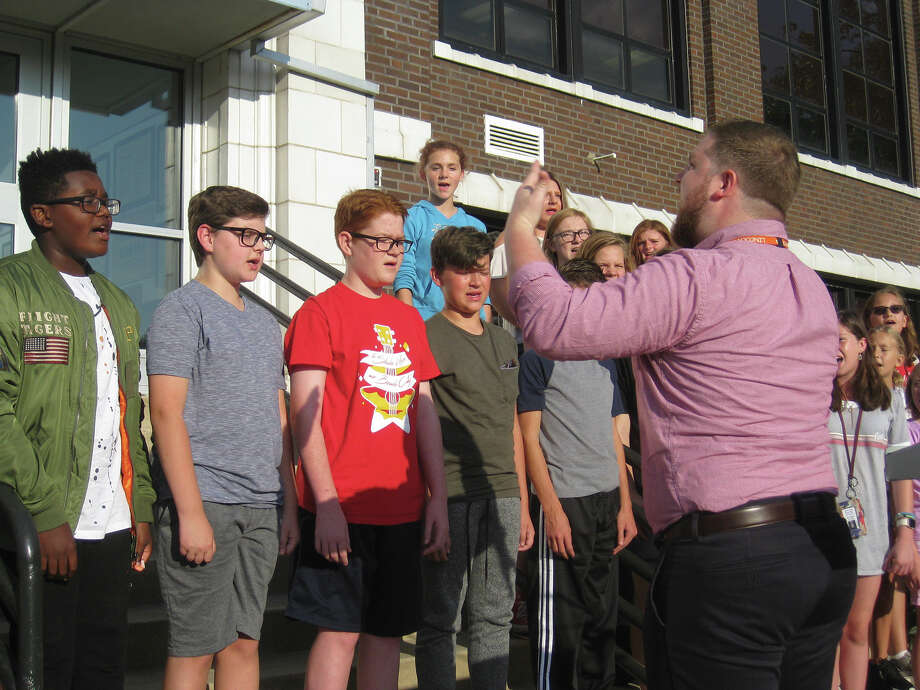 "Under the direction of Tom O'Malley, right, the Lincoln Middle School Chorus performs the ""Star Spangled Banner"" during the Constitution Week Celebration. Photo: Julia Biggs"
