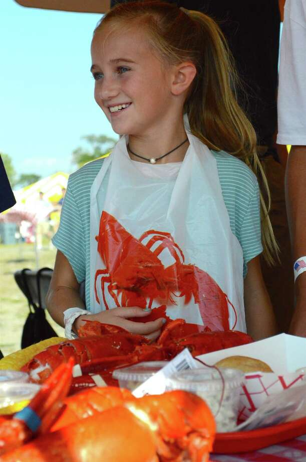 Pai Bausman, 10, of New Canaan, gets ready to eat at the Rotary Club of Westport's  6th annual LobsterFest at Compo Beach, Saturday, Sept. 16, 2017, in Westport, Conn. Photo: Jarret Liotta / For Hearst Connecticut Media / Westport News Freelance