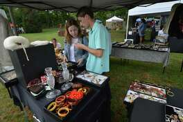 Stamford's Jessica Ortega and Darien's Kevin Eppley look over some vintage jewlery at the Lockwood-Mathews Mansion Museum tenth annual Old-fashioned Flea Market on Sunday September 17, 2017 in Norwalk Conn