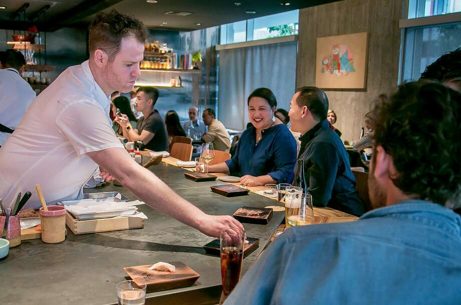 Robin in S.F.: Chef Adam Tortosa places sushi on customers' plates. Photo: John Storey, Special To The Chronicle