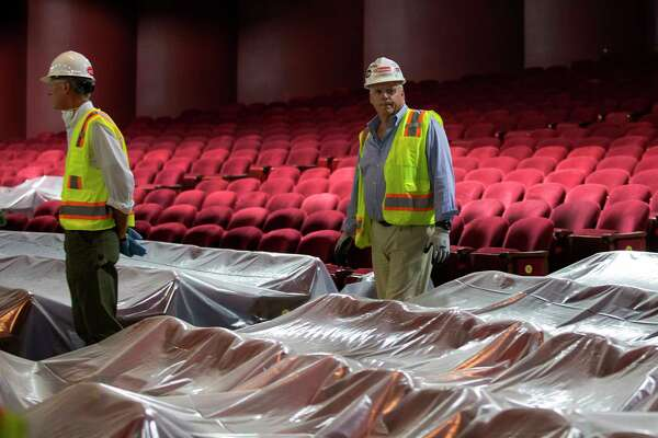 Jim Springer, center, with Gilbane Construction, walks through a theater isle while leading media on a tour of the flood damaged Wortham Theater Center Friday, Sept. 22, 2017, in Houston.