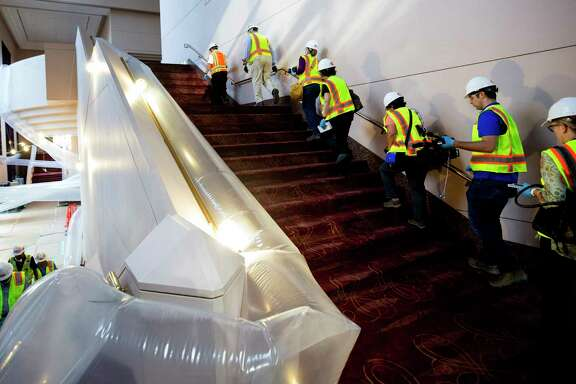 Members of Gilbane Construction led media on a tour of the flood damaged Wortham Theater Center Friday, Sept. 22, 2017, in Houston.