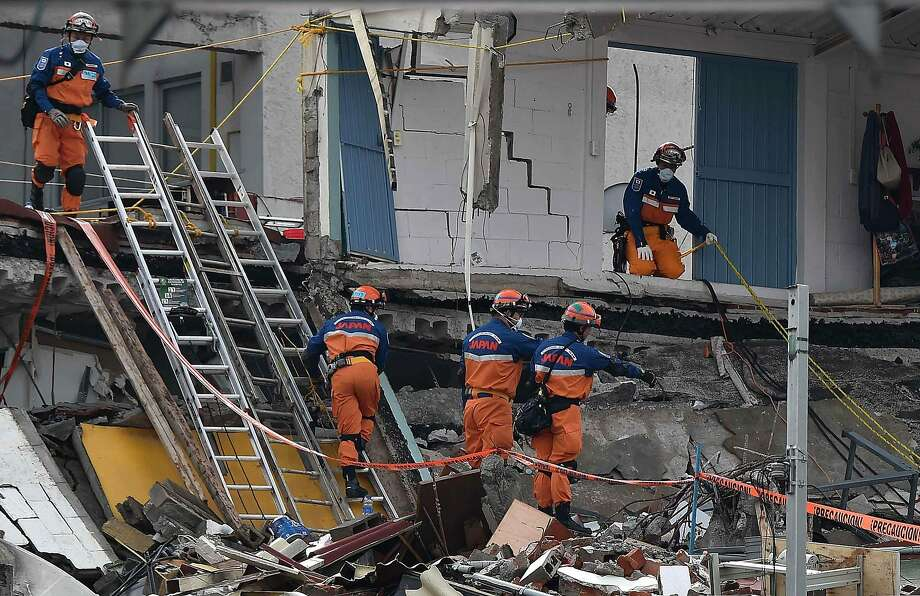 A crew from Japan assists rescue efforts at a collapsed building in Mexico City. The 7.1-magnitude quake killed at least 293 people and caused severe damage. Photo: YURI CORTEZ, AFP/Getty Images