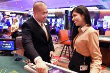 Table games shift manager David Vatthanavong, left, and Spanish 21 dealer Devica Phillips ready for patrons as the Rivers Casino and Resort opens Wednesday Feb. 8, 2017 in Schenectady, NY.  (John Carl D'Annibale / Times Union)