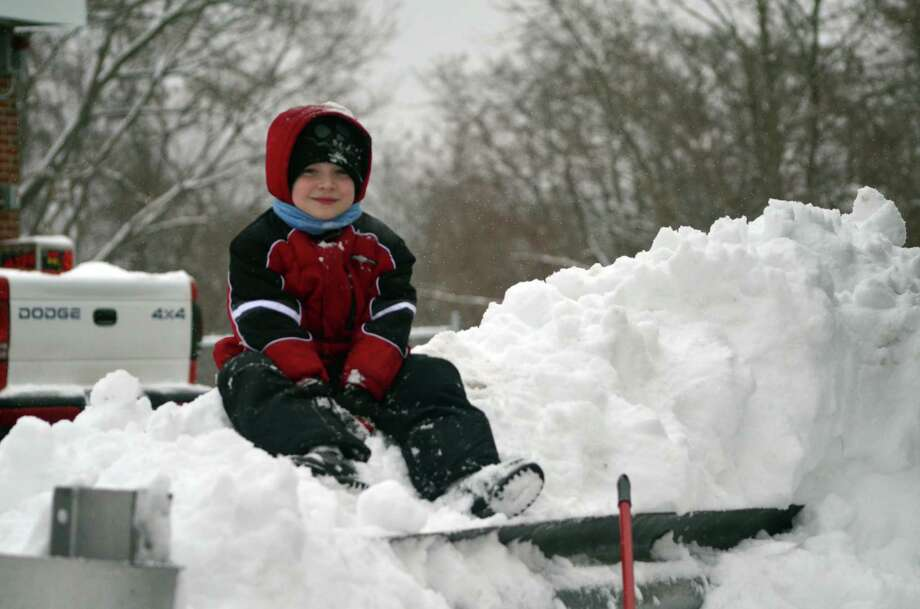Noah, age 8, plays in the snow in Torrington. (Shako Liu-Register Citizen)