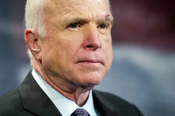 FILE -- In this July 27, 2017, file photo, Sen. John McCain, R-Ariz., speaks to reporters on Capitol Hill in Washington.  McCain says he won't vote for the Republican bill repealing the Obama health care law. His statement likely deals a fatal blow to the last-gasp GOP measure in a Senate showdown expected next week.