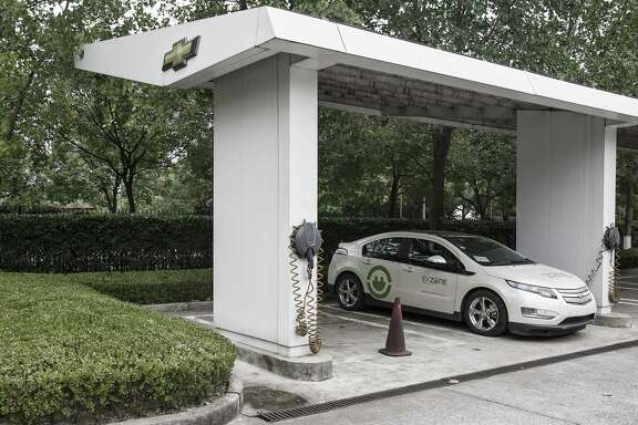 A Chevrolet Volt electric vehicle sits parked at a charging station at the General Motors China headquarters in Shanghai, China, on Sept. 15, 2017.