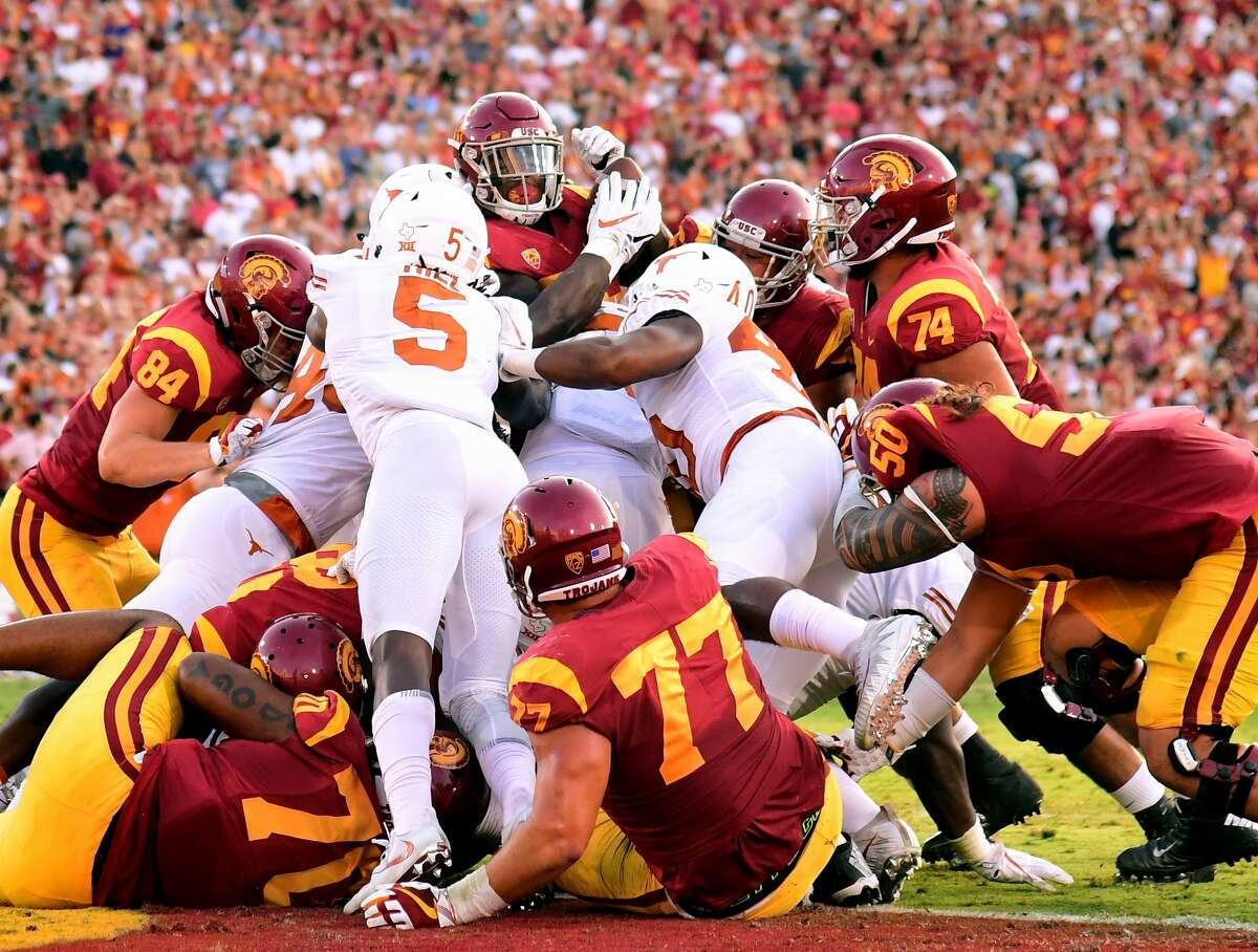 LOS ANGELES, CA - SEPTEMBER 16: Vavae Malepeai #29 of the USC Trojans is stopped by the Texas Longhorns defense at the goal line during the first quarter at Los Angeles Memorial Coliseum on September 16, 2017 in Los Angeles, California. (Photo by Harry How/Getty Images)