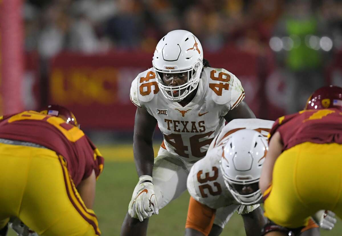 Texas linebacker Malik Jefferson (46) gets set to run a play during the second half of an NCAA college football game against Southern California, Saturday, Sept. 16, 2017, in Los Angeles. USC won 27-24 in overtime. (AP Photo/Mark J. Terrill)