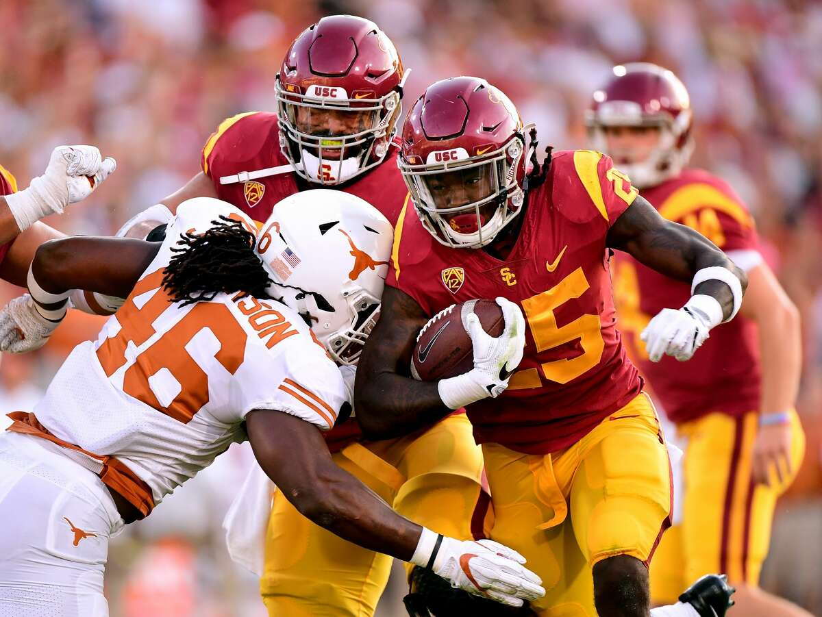 LOS ANGELES, CA - SEPTEMBER 16: Ronald Jones II #25 of the USC Trojans carries the ball as he is hit by Malik Jefferson #46 of the Texas Longhorns during the first quarter at Los Angeles Memorial Coliseum on September 16, 2017 in Los Angeles, California. (Photo by Harry How/Getty Images)