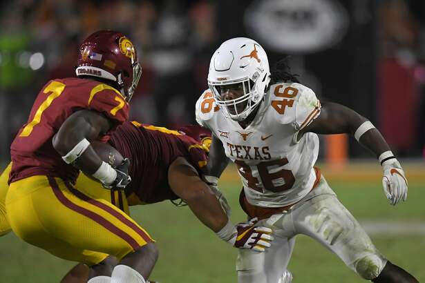 Texas linebacker Malik Jefferson, right, tries to tackle Southern California running back Stephen Carr during the second half of an NCAA college football game, Saturday, Sept. 16, 2017, in Los Angeles. USC won 27-24 in overtime. (AP Photo/Mark J. Terrill)