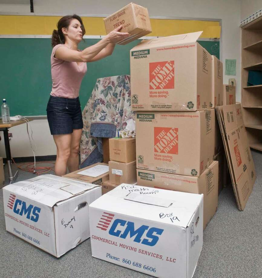 Marie Williams, a music teacher for three years at Mill Ridge Intermediate School, packs up her class belongings on this last day of school and will head to King Street Intermediate School next year. Mill Ridge Intermediate School is closing. Wednesday, June 23, 2010 Photo: Scott Mullin / The News-Times Freelance