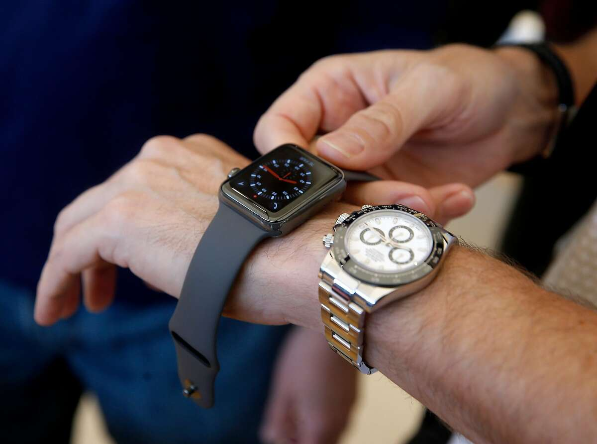 Rich Spangler compares his analog wristwatch with the Apple Watch Series 3 after it went on sale to the public at the Union Square Apple Store in San Francisco, Calif. on Friday, Sept. 22, 2017.