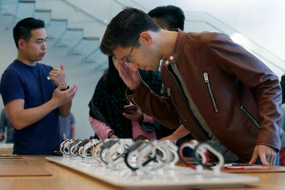 Billy Rosen browses through the Apple Watch Series 3 display before purchasing one after it went on sale to the public at the Union Square Apple Store in San Francisco, Calif. on Friday, Sept. 22, 2017.