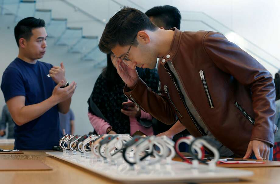 Billy Rosen browses through the Apple Watch Series 3 display before purchasing one after it went on sale to the public at the Union Square Apple Store in San Francisco, Calif. on Friday, Sept. 22, 2017. Photo: Paul Chinn, The Chronicle