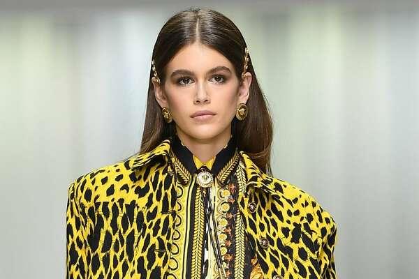 MILAN, ITALY - SEPTEMBER 22:  Kaia Gerber walks the runway at the Versace show during Milan Fashion Week Spring/Summer 2018 on September 22, 2017 in Milan, Italy.  (Photo by Venturelli/WireImage)