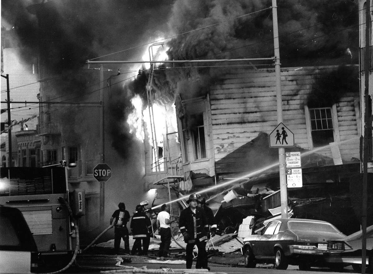 Firefighters trying to save houses in the Marina district of San Francisco after the quake on October 17, 1989.