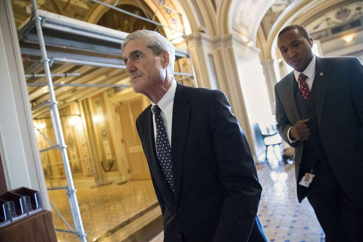 FILE - In this June 21, 2017 file photo, special counsel Robert Mueller departs after a closed-door meeting with members of the Senate Judiciary Committee about Russian meddling in the election and possible connection to the Trump campaign, on Capitol Hill in Washington. Mueller's team of investigators is seeking information from the White House related to Michael Flynn's stint as national security adviser and about the response to a meeting with a Russian lawyer that was attended by President Donald Trump's oldest son, The Associated Press has learned. (AP Photo/J. Scott Applewhite, File)