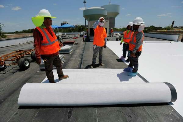 Beldon Roofing workers on the job at Sunshine Cottage during the heat of the day on Friday, July 21, 2017. When climate scientists look at how global warming will change San Antonio, one clear signal emerges: An already-hot city is going to get hotter. By 2040 to 2060, nearly every day of an average July or August will be above 100 degrees, according to one computer model. That kind of warming is going to drive northward shifts in plant and animal ranges, lower agricultural productivity and a decline in the outdoor labor force. Predicting rainfall in the future is more difficult. While climate models predict a slight increase in intense rainstorms with longer dry periods in between, climate scientists say that we are heading into the unknown.