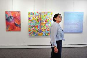 Marguerite Weinert, gallery manger for the Stamford Art Association, looks over the show she just hung for the 37th annual Faber Birren National Color Award Show at the Stamford Art Association Gallery in Stamford, Conn., Friday, Sept. 15, 2017. The opening for the show, that celebrates artists and their use of color in the tradition established by Birren, a noted Stamford color theorist who passed away in 1988, is Sunday, Sept. 24, from 4 p.m. - 6 p.m. at the gallery located at 39 Franklin Street.