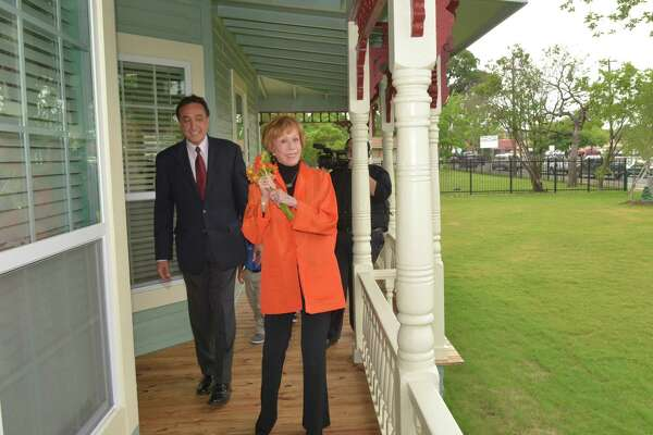 Former San Antonio mayor Henry Cisneros and Carol Burnett tour the renovated house and wraparound porch on West Commerce. She lived in the original with her beloved grandmother until age 7. She was happy to see it being put to good use as a learning center for needy neighborhood kids and their parents.