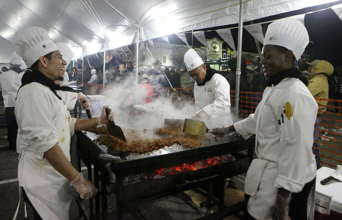 Saint Philip's College culinary students cook for the 39th Annual Cowboy Breakfast in 2017. A crowd of 40,000 is expected this year at the breakfast.