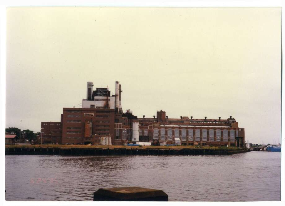 The former United Illuminating Co. power plant on Steel Point in Bridgeport. The power plant opened in 1923 and was retired in 1982. It was around that same time that plans for the creation of a tourist destination on the East Side peninsula were unveiled. The plant was demolished in 1995 and the property was acquired by the city for $14.9 million in 2006. Photo: Bridgeport Public Library / Bridgeport History Center Connecticut Post Contributed
