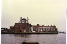 The former United Illuminating Co. power plant on Steel Point in Bridgeport. The power plant opened in 1923 and was retired in 1982. It was around that same time that plans for the creation of a tourist destination on the East Side peninsula were unveiled. The plant was demolished in 1995 and the property was acquired by the city for $14.9 million in 2006.