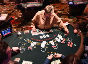 A dealer works a blackjack table at Rivers Casino & Resort Schenectady on Wednesday, Feb. 1, 2017, during a media tour in Schenectady, N.Y. The game was used as a training exercise for casino employees using faux money. (Will Waldron/Times Union)