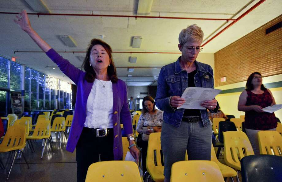 From left, Nancy Henkes and Lisa Steigerwald, both of Greenwich and members of the Presbyterian Church of Old Greenwich, participate in a Night of Unity and Peace service at Trinity Catholic High School in Stamford, Connecticut on Thursday, Sept. 21, 2017. The event, in connection with the United Nation's  International Day of Peace, featured  music led by Angelo Natalie and Dani Wasserman. Ecumenical speakers including Rev. Bill Gestal from Presbyterian Church of Old Greenwich, Rico Arocha from Young Life Youth Ministry and Father Joseph Gill, Chaplain at Trinity Catholic High School. Also, Christian rap artist, Zabbai, performed before members of various area congregations and churches during a night of Peace, Prayer and Worship. Photo: Matthew Brown / Hearst Connecticut Media / Stamford Advocate