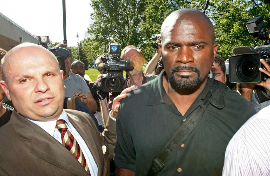FILE - In this May 6, 2010, file photo, Pro Football  Hall of Famer Lawrence Taylor, right, and his attorney Arthur Idala, left, leave the Ramapo Police Department in Suffern, N.Y.  Taylor has been indicted by a suburban New York grand jury on charges of rape, criminal sexual act and sexual abuse. The indictment Wednesday, June 23, 2010,  comes after his May 6 arrest at a Holiday Inn. Photo: Kathy Willens