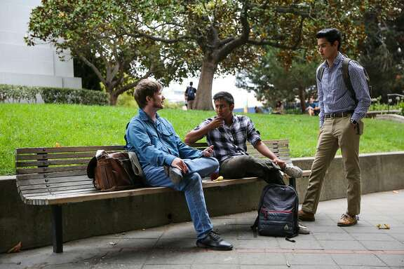 (l-r) Mike Wright, Pranav Jandhylala and Bryce Kasamoto chat during a break between classes at UC Berkeley in Berkeley, Calif., on Wednesday, Sept. 20, 2017. They are all part of the Berkeley Patriot.