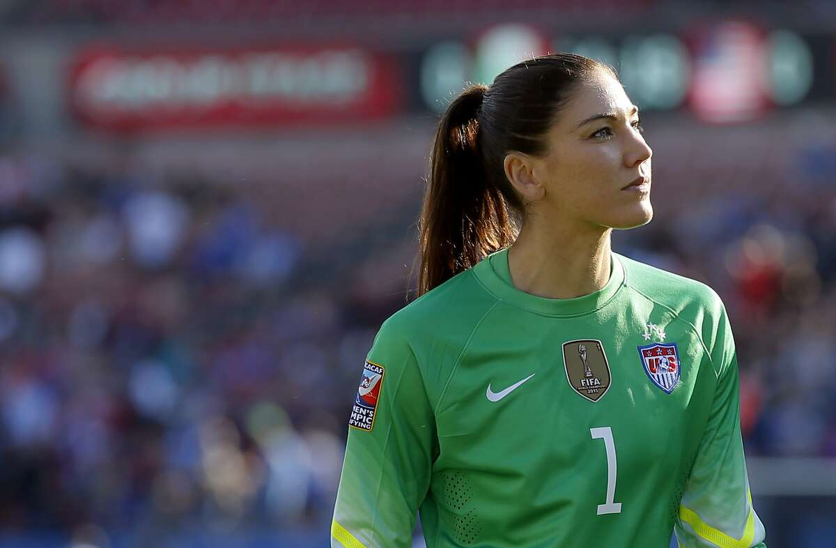 FILE - In this Feb. 13, 2016, file photo, United States goalie Hope Solo walks off the field at half time of a CONCACAF Olympic qualifying tournament soccer match against Mexico in Frisco, Texas. Solo says she's settled a grievance with U.S. Soccer over her suspension from the women's national team last year following comments she made at the Rio Olympics. (AP Photo/Tony Gutierrez, File)