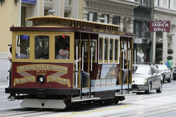 A cable car makes its way past the Tadich Grill on California Street in San Francisco, Monday, June 27, 2011. The popular San Francisco cable car line is back in business Monday following a six-month rehabilitation project. The California Street cable cars have been off-line since Christmas Eve for $24 million in repairs. It was the line's first major overhaul since all three of the city's cable car lines were rebuilt in the 1980s. During the closure, buses ran along the east-west route, but the iconic cable cars are returning just in time for the peak tourist season.