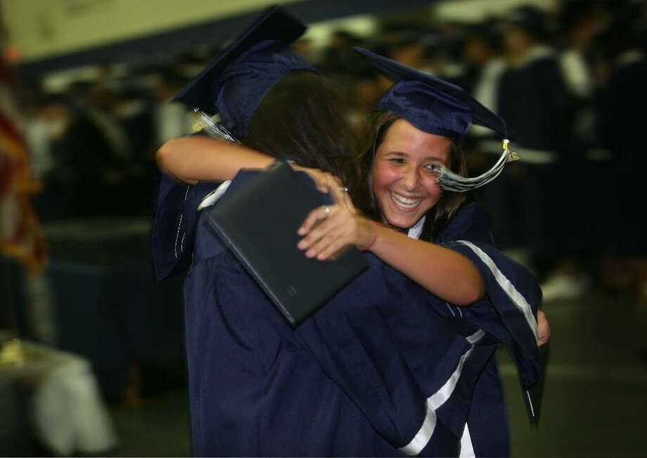 Friends Katya Strage and Jillian Ciferri hug after receiving their diplomas at the Staples High School graduation on Wednesday, June 23, 2010 at Staples High School in Westport. Photo: Brian A. Pounds / Connecticut Post