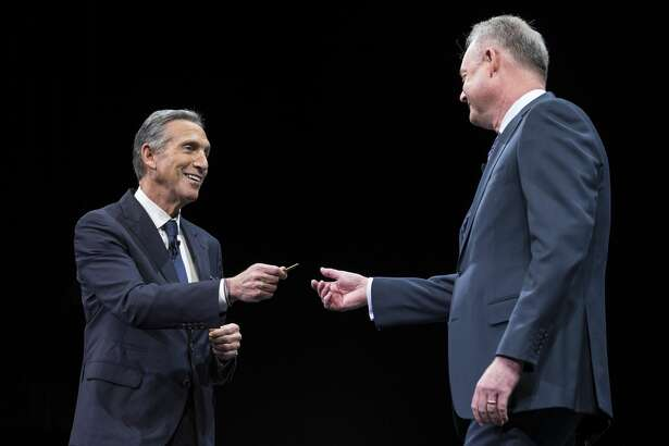 SEATTLE, WA - MARCH 22: CEO Howard Schultz (L) hands over the key to the original Starbucks store to President and Chief Operating Officer Kevin Johnson during the Starbucks annual meeting of shareholders on March 22, 2017 in Seattle, Washington. Johnson will be replacing Schultz and CEO of the company. Schultz has kept the key in his pocket every day since he took over the company more than 30 years ago. (Photo by Stephen Brashear/Getty Images)