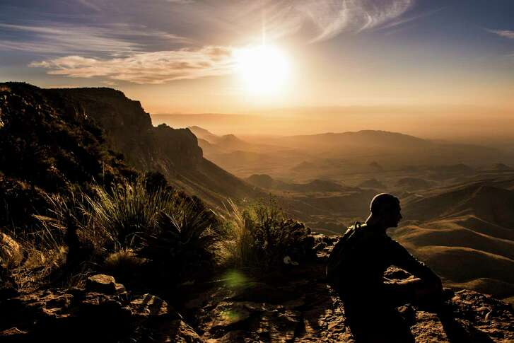 Vipul Devluk takes in the sunrise from the South Rim at Big Bend National Park Monday, April 10, 2017. ( Michael Ciaglo / Houston Chronicle)