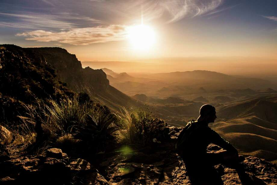 Vipul Devluk takes in the sunrise from the South Rim at Big Bend National Park Monday, April 10, 2017. ( Michael Ciaglo / Houston Chronicle) Photo: Michael Ciaglo, Staff / Michael Ciaglo