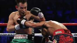Nonito Donaire (let) of the Philippines and Jessie Magdaleno exchange punches during their WBO junior featherweight championship fight at the Thomas & Mack Center on Nov. 5, 2016 in Las Vegas.