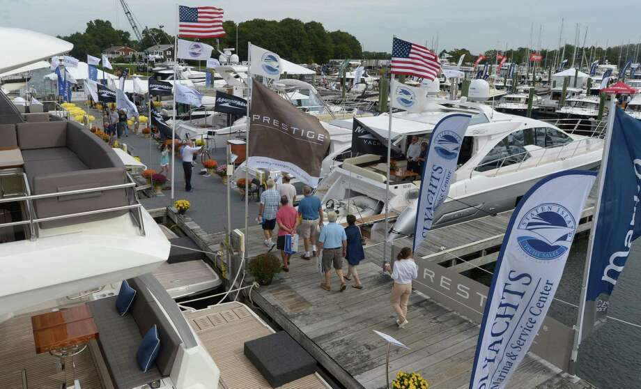 The 2017 Progressive Insurance Norwalk Boat Show at Cove Marina Thursday, September 21, 2017, in Norwalk, Conn. The show is the Northeast's premier in-water boating event offering a destination to shop and compare 300 boats side by side as well as a Try it Cove, boating lessons, the new Touch-a-Boat event for kids, plus free boat rides, and live music. Photo: Erik Trautmann / Hearst Connecticut Media / Norwalk Hour