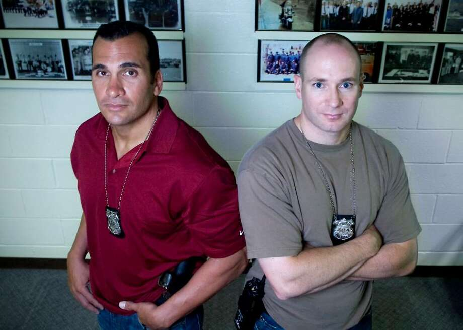 Stamford Police officers Richard Gasparino and Adrian Novia, both with the Narcotics & Organized Crime Unit, will be honored as 2010 Officers of the Year at an event at The Italian Center.  They are photographed in the Stamford Police Station in Stamford, Conn. on Wednesday June 23, 2010. Photo: Kathleen O'Rourke / Stamford Advocate