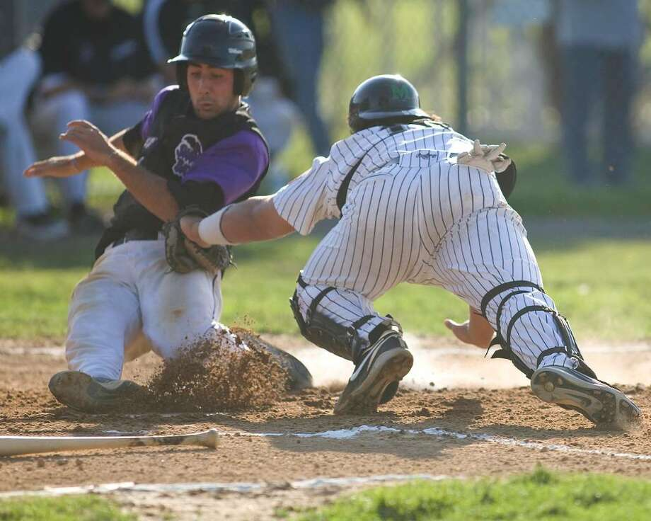 Westerners catcher Thor Meeks tags out Keene's Mark Onorati at home plate Wednesday night at Rogers Park. Photo: Barry Horn / The News-Times Freelance
