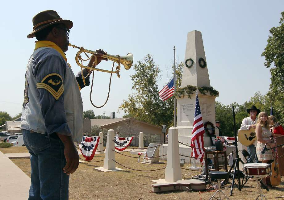 A member of the Bexar County Buffalo Soldiers plays taps in 2012 at the Treue der Union in Comfort. The monument honors German Texans who were fleeing to avoid conscription or to join the Union. Most were killed in a clash with Confederate soldiers. Survivors were massacred. Photo: Express-News File Photo / ©2012 San Antonio Express-News