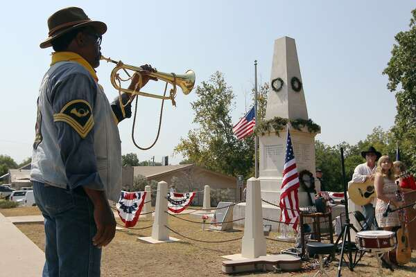 A member of the Bexar County Buffalo Soldiers plays taps in 2012 at the Treue der Union in Comfort. The monument honors German Texans who were fleeing to avoid conscription or to join the Union. Most were killed in a clash with Confederate soldiers. Survivors were massacred.