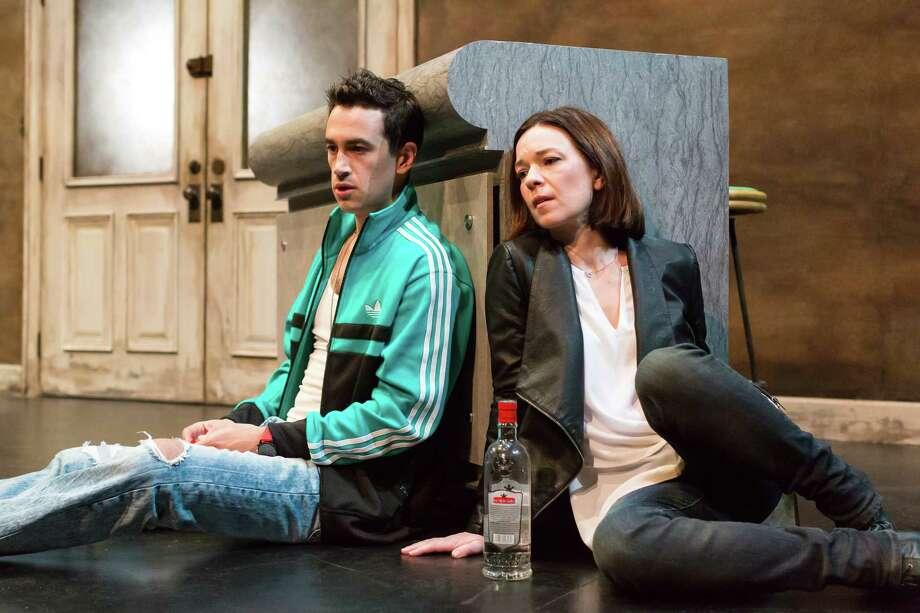 "Stephen Stocking portrays Feliks and Elizabeth Bunch is Mariya in Alley Theatre's world premiere of ""Describe the Night"" by Rajiv Joseph. Photo: Lynn Lane / Lynn Lane"