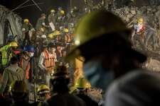 Rescue workers and volunteers search for survivors in the rubble of a building on Amsterdam Avenue late into the night in the Condesa neighborhood of Mexico City on Tuesday following the 7.1 earthquake.